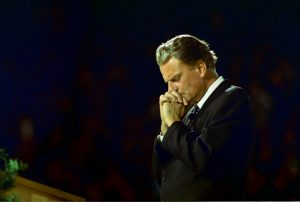 Billy Graham needs prayers according to son.